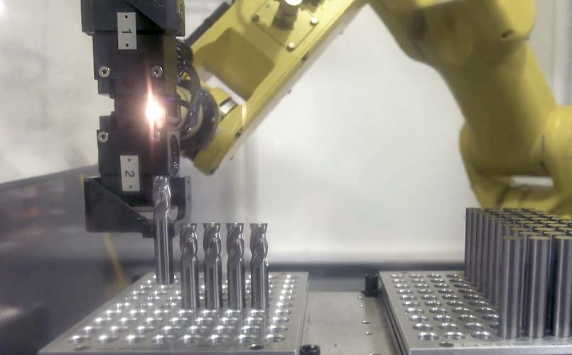 Robotic arm autmating manufacturing cells