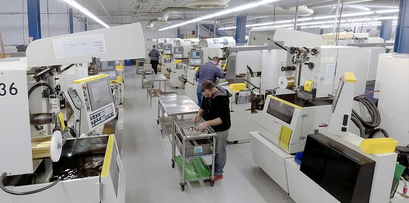 Machinists working on EDM machines for medical manufacturing
